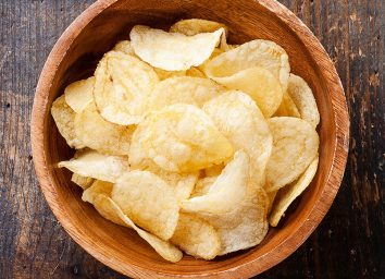Potato chips in wooden bowl