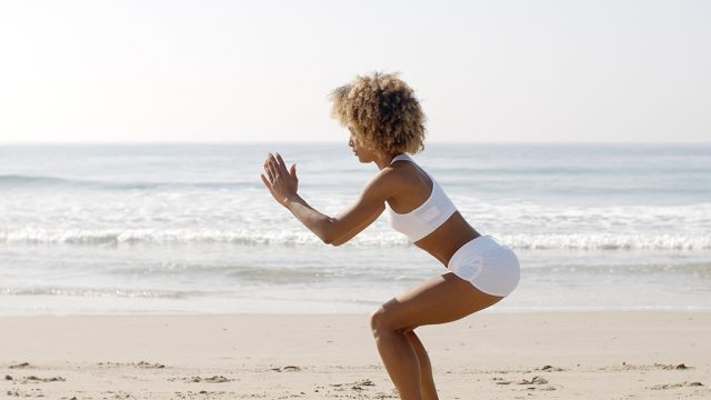 Squat exercise on beach.jpg