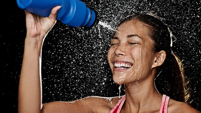 Woman with water bottle after workout