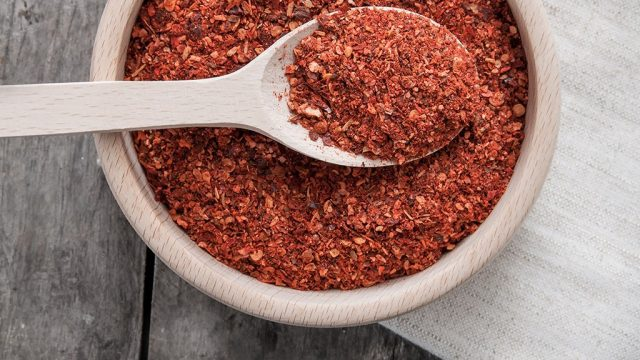 Chili spice in wooden bowl