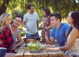 Three couples at picnic table
