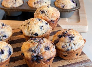 blueberry muffins on serving board