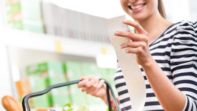 Woman with receipt groceries.jpg