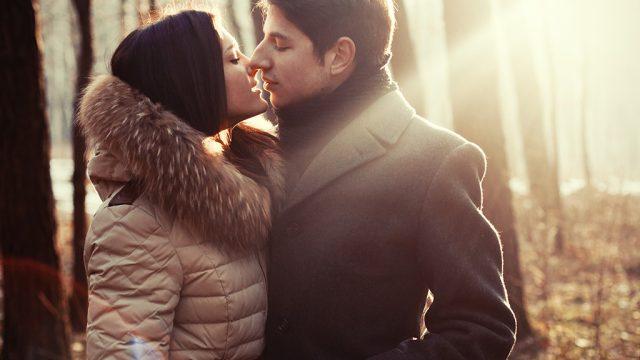 Couple kissing winter romance.jpg