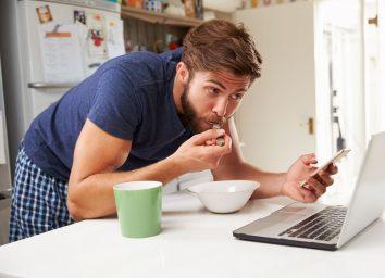man rushing through quick breakfast