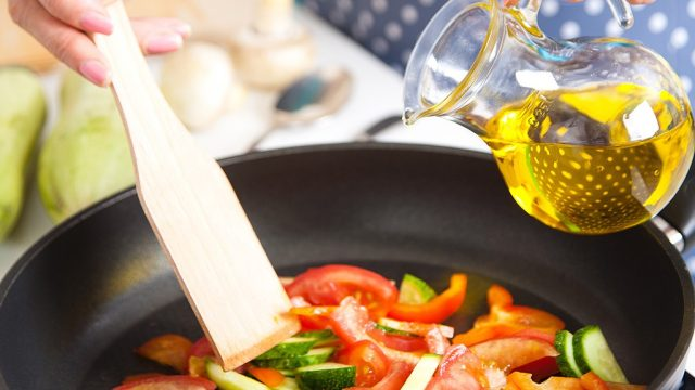 Cooking tomatoes with olive oil in skillet