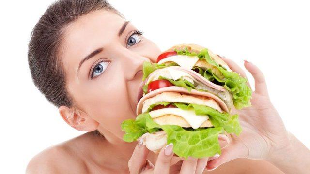 Woman eating giant sandwich.jpg