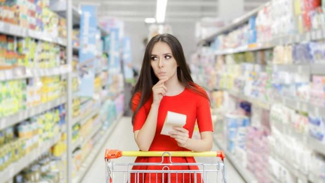 Woman grocery shopping aisle.jpg