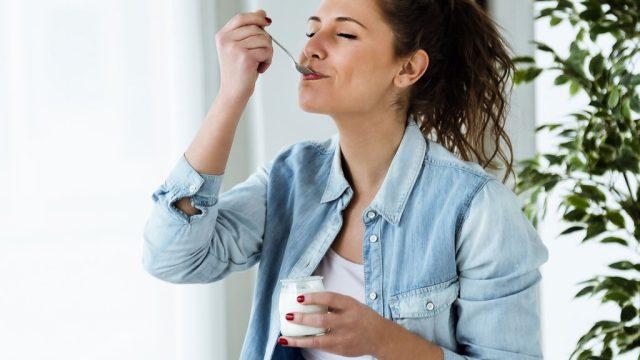 Woman eating yogurt.jpg