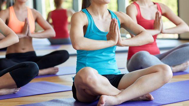 Women meditating in yoga class.jpg