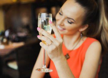 Woman drinking white wine