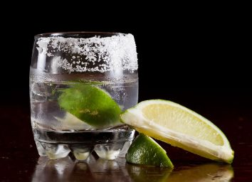 Tequila neat with lime lemon and salt