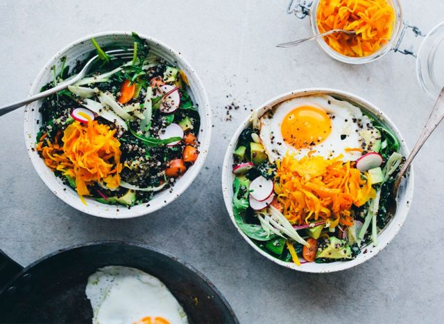Green salads in bowls with eggs