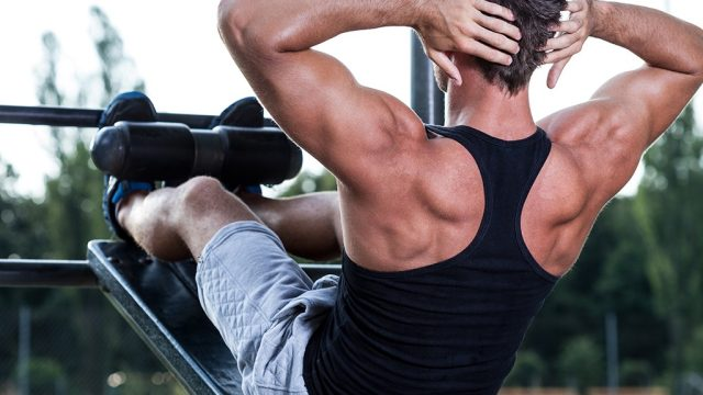 Man doing crunches outdoors
