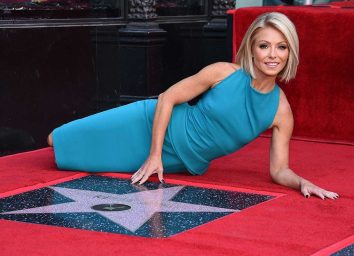 Kelly Ripa posing with star on Hollywood Walk of Fame