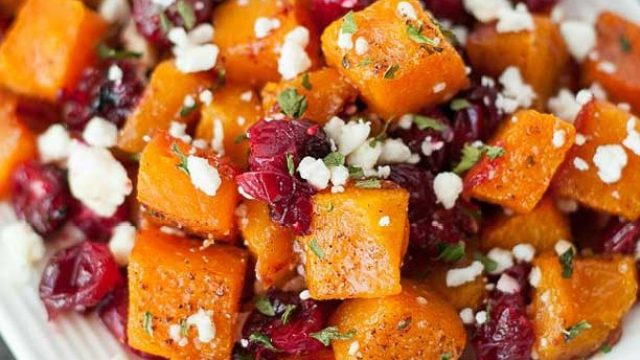 Diced butternut squash with cranberries and goat cheese
