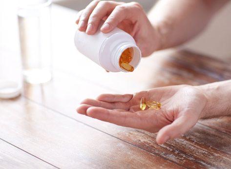 omega 3 fish oil pills in hand