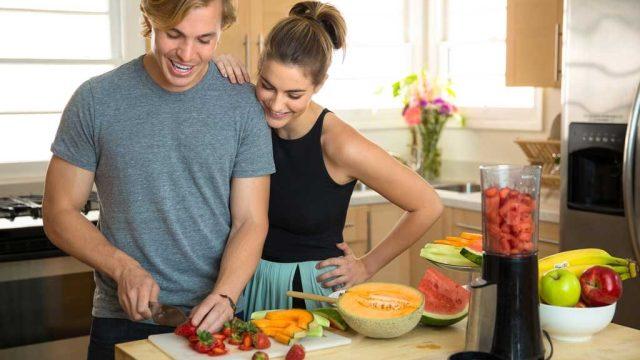 Couple chopping fruits.jpg