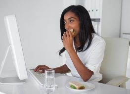 woman eating desk