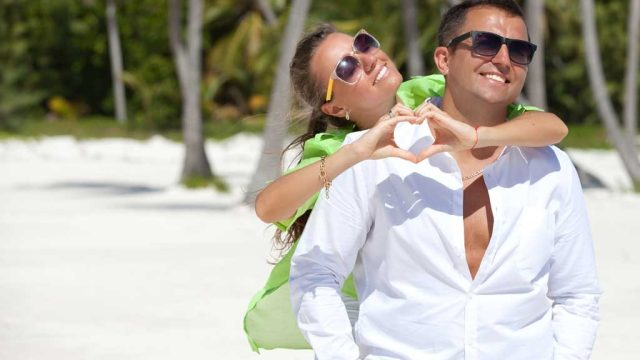 Couple on beach smiling.jpg