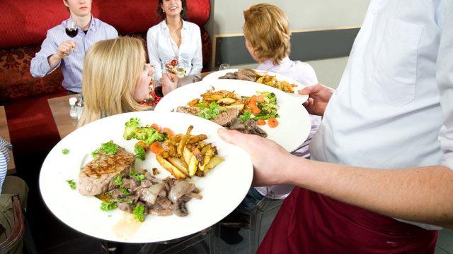 Waiter plates hands full.jpg