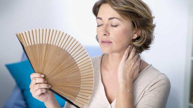 menopausal woman experiencing hot flash