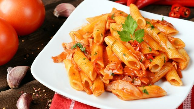 Penne pasta on white plate