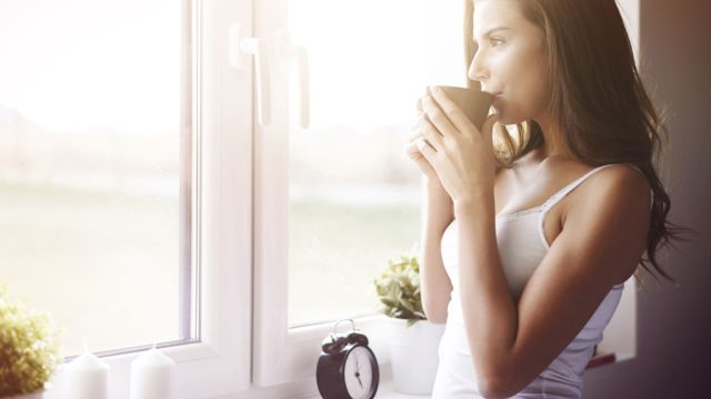 Woman sipping tea relaxed.jpg