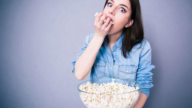 Woman eating popcorn.jpg