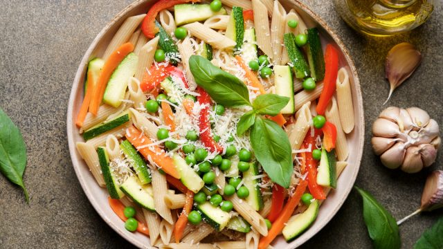 vegetable pasta primavera with carrots zucchini peppers peas