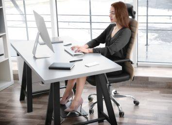 Woman sitting at desk upright good posture