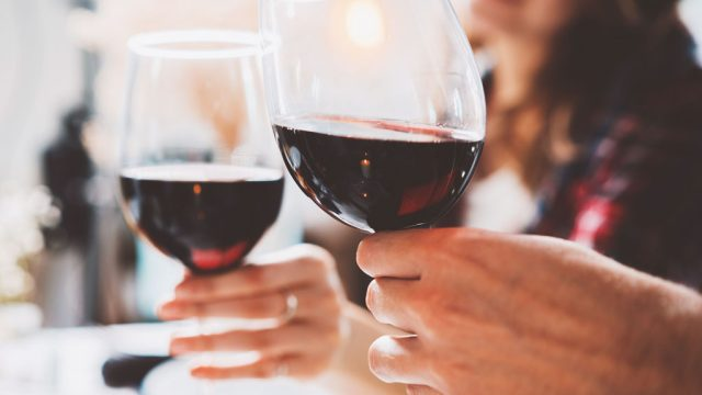 Couple cheers red wine
