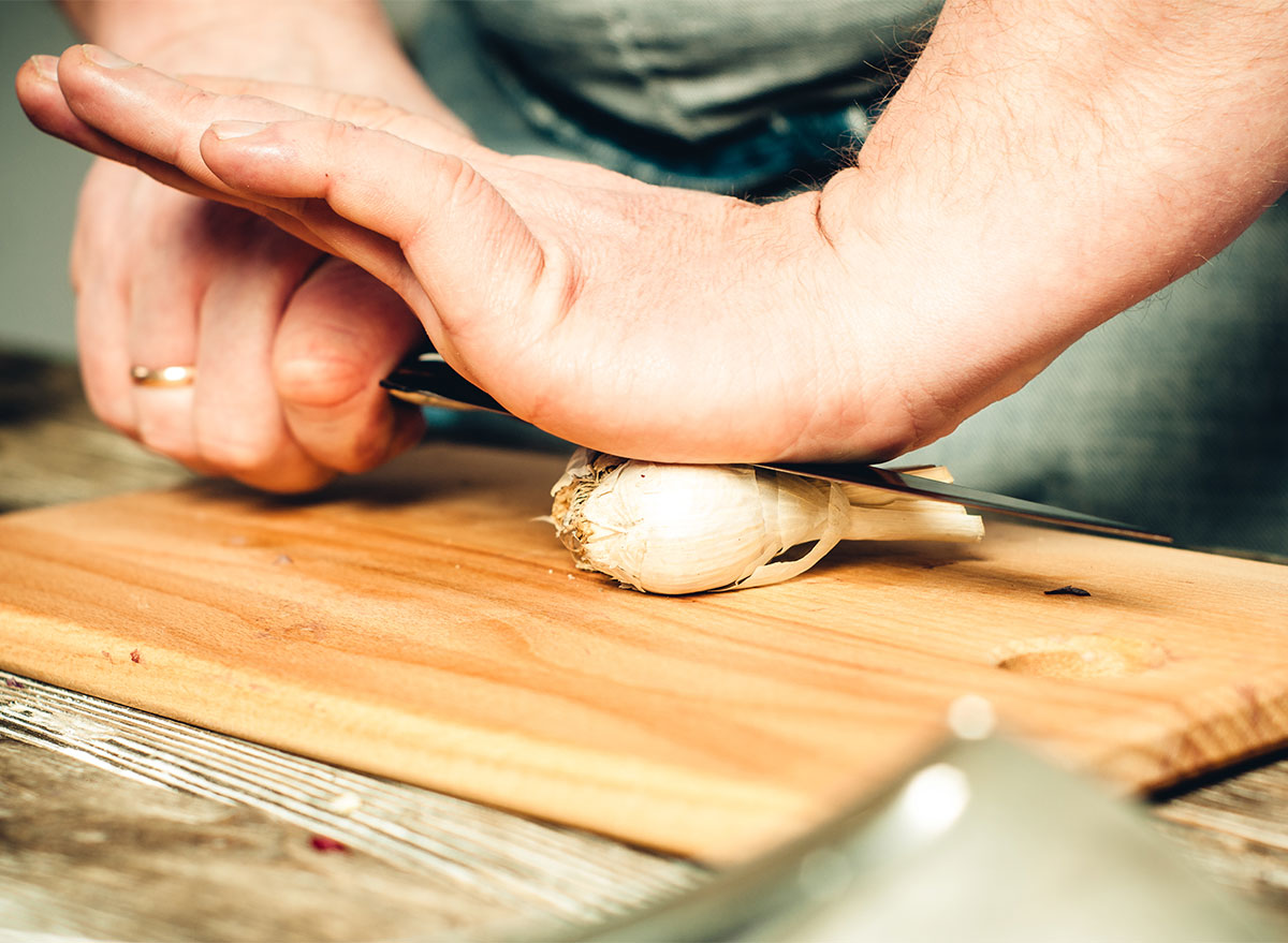 crushing garlic with a knife