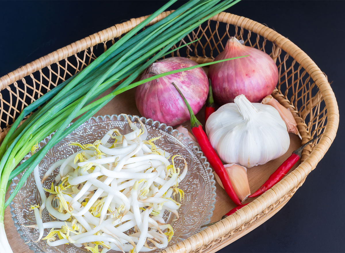 chives and garlic and bean sprouts in wicker basket