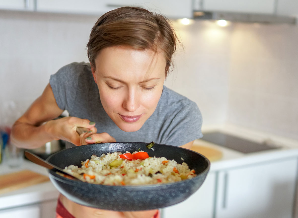 Woman smelling dinner