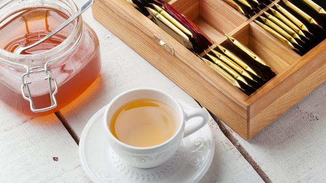 box of tea bags cup of tea honey