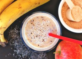 High protein banana apple smoothie with scoop protein powder