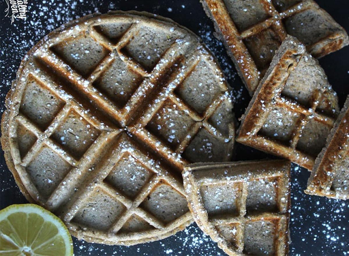 lemon buckwheat waffles dusted with powdered sugar