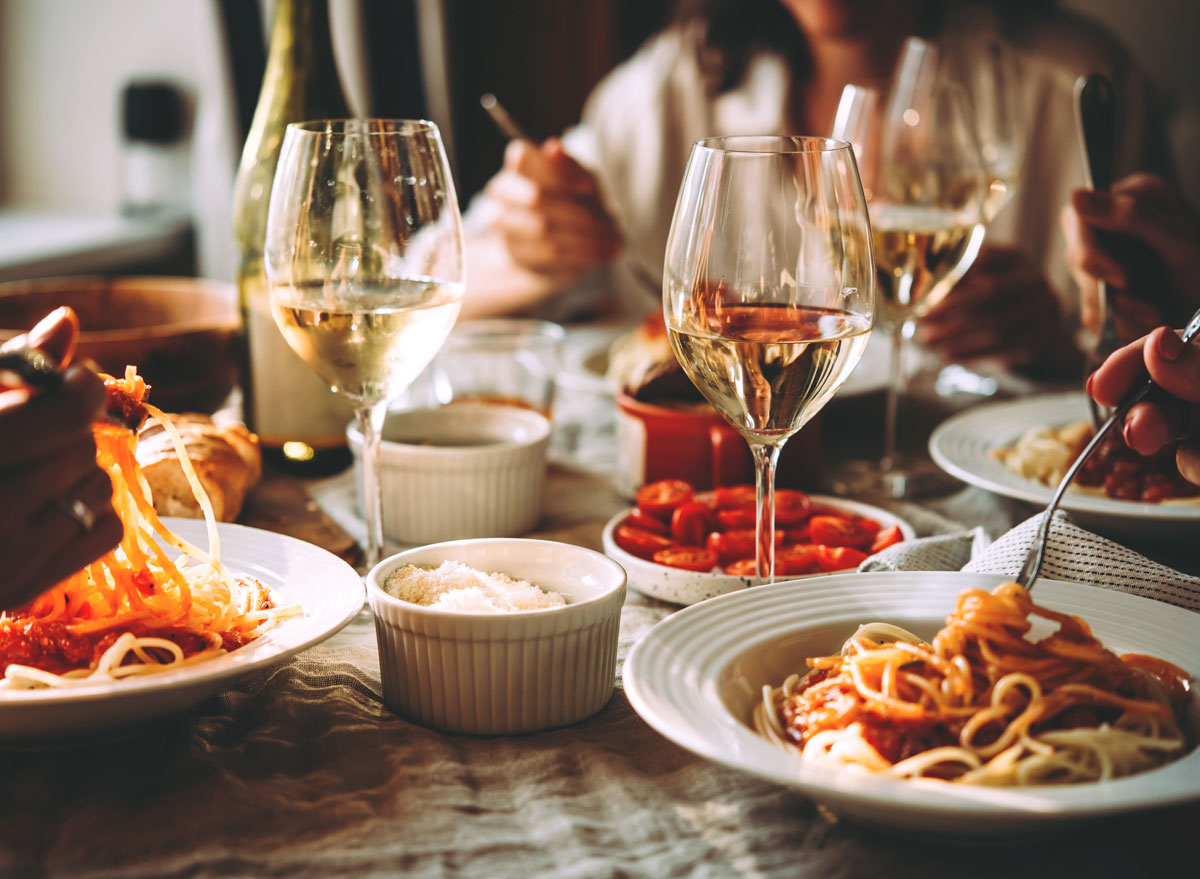 Friends eating a pasta dinner at a restaurant