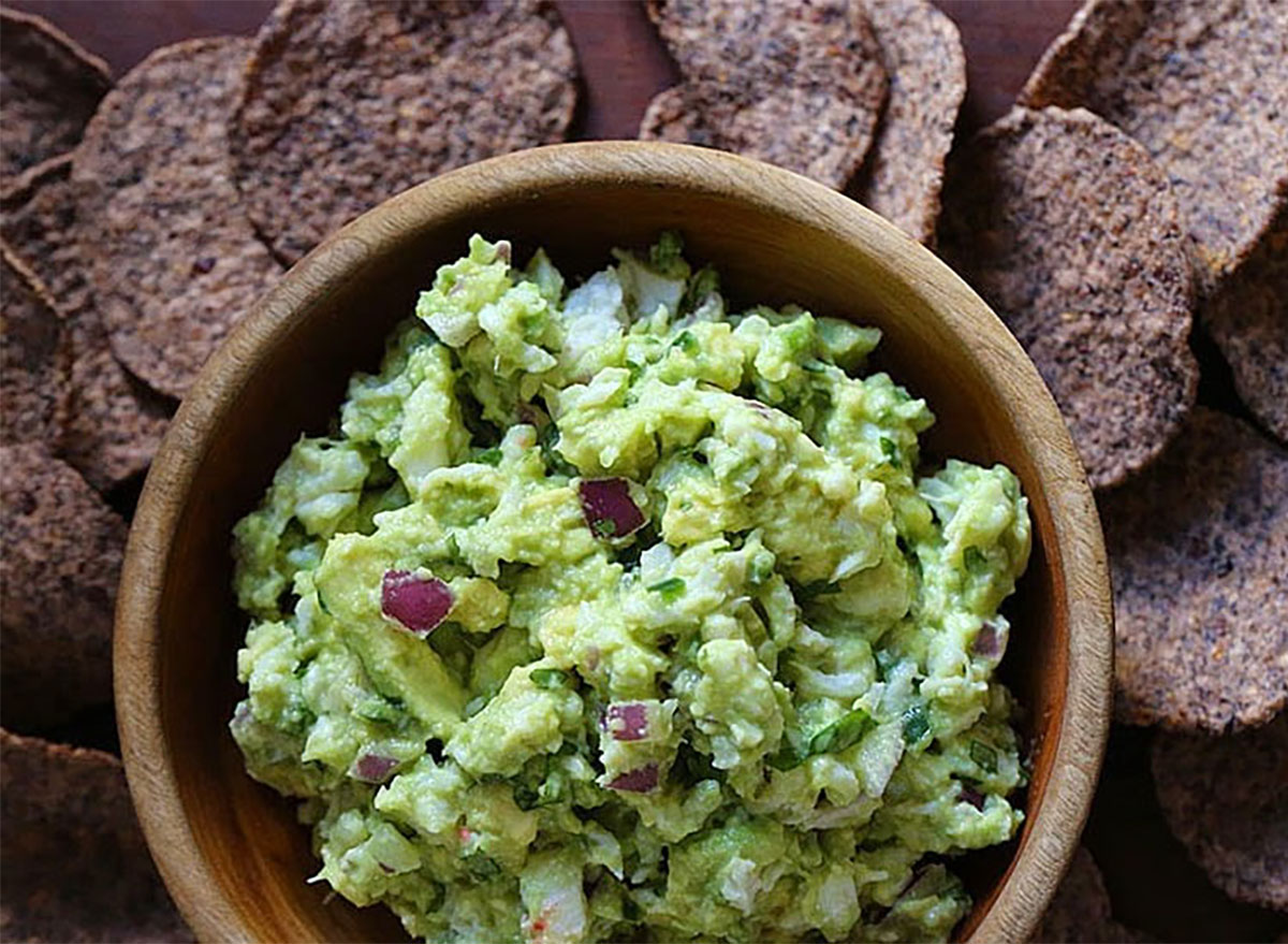 crab guacamole in bowl with chips