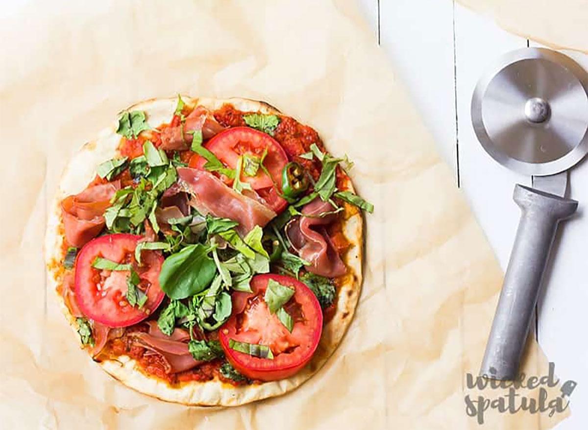 paleo pizza crust with pizza cutter