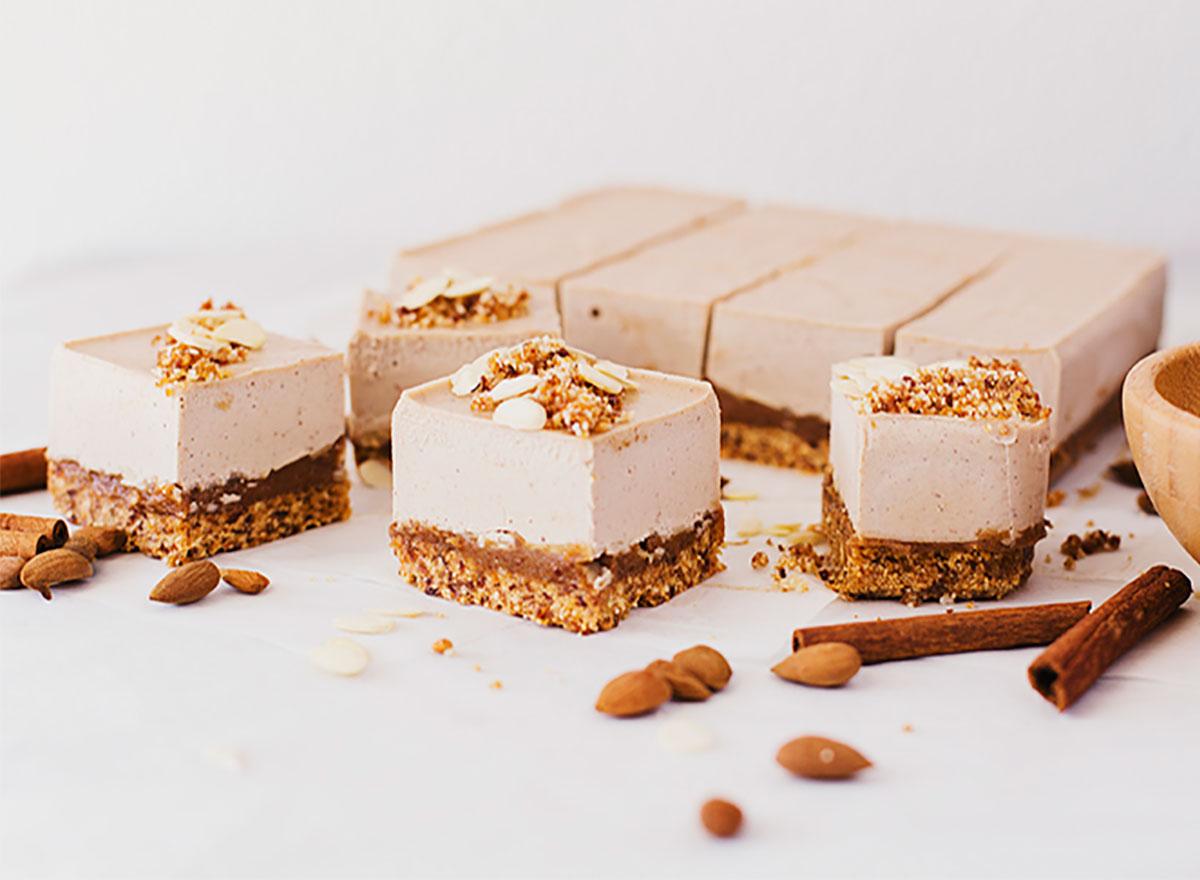 individual squares of almond caramel cheesecake