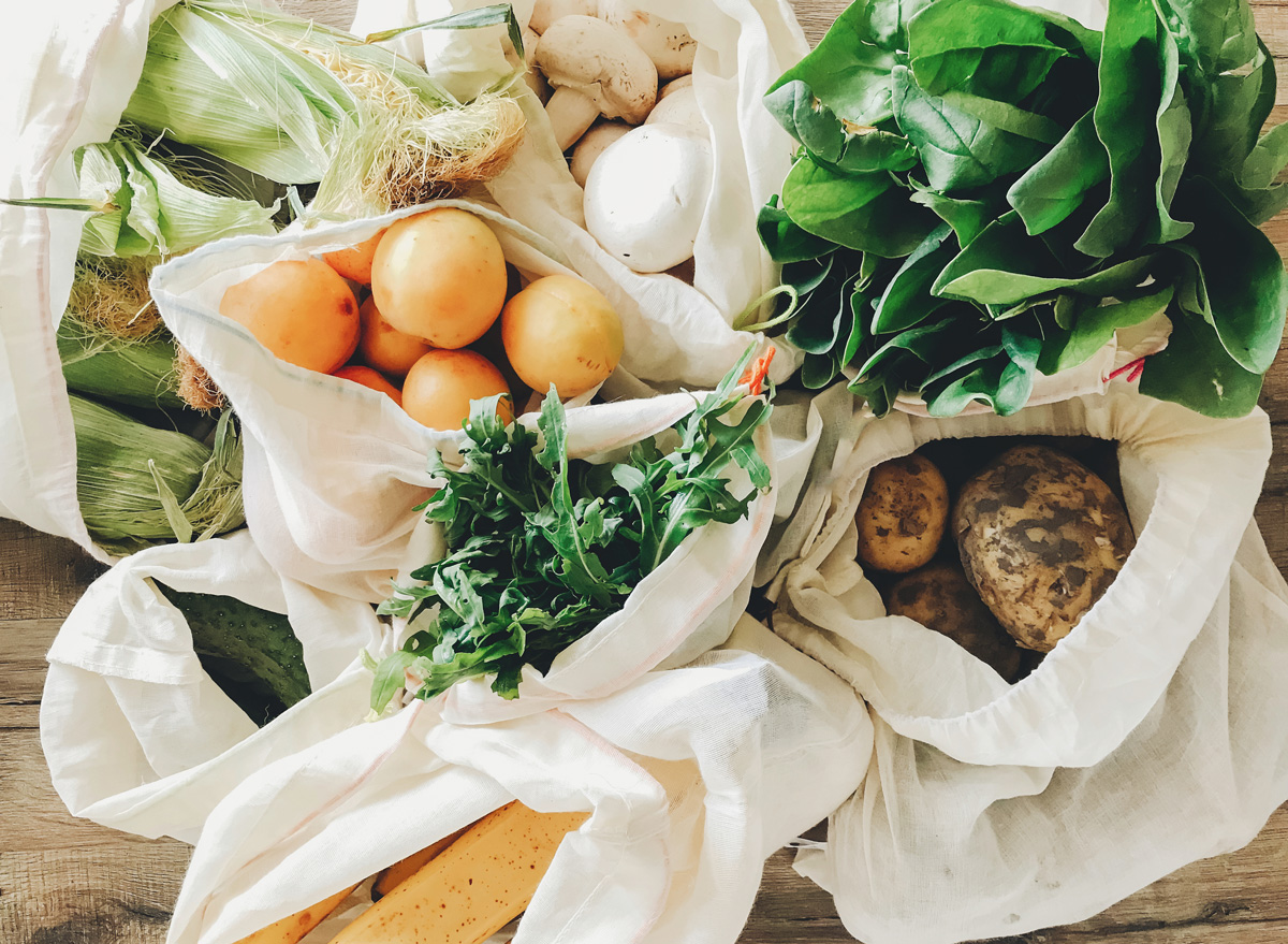 shopping for organic food in reuseable grocery bags