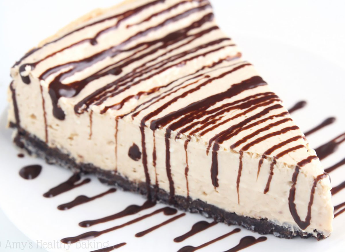 slice of peanut butter cheesecake topped with chocolate drizzle