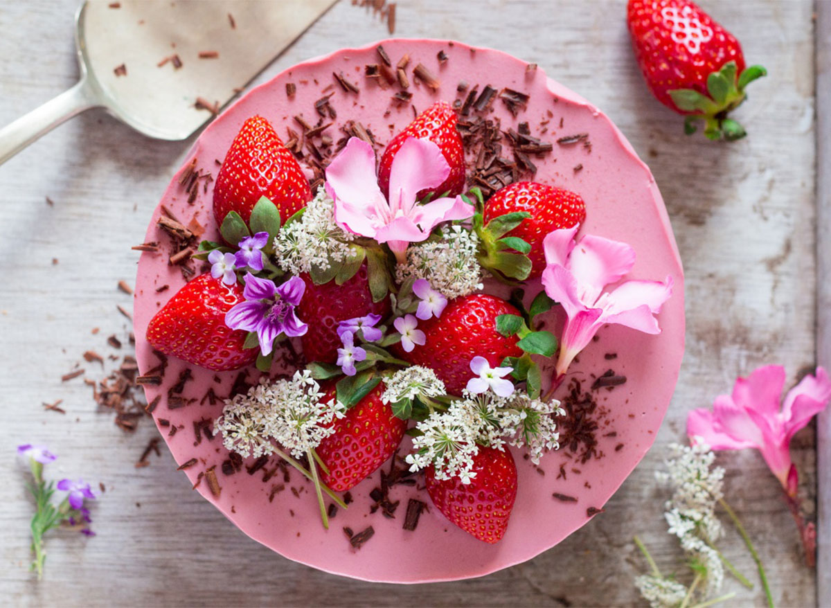whole vegan strawberry cheesecake topped with flowers
