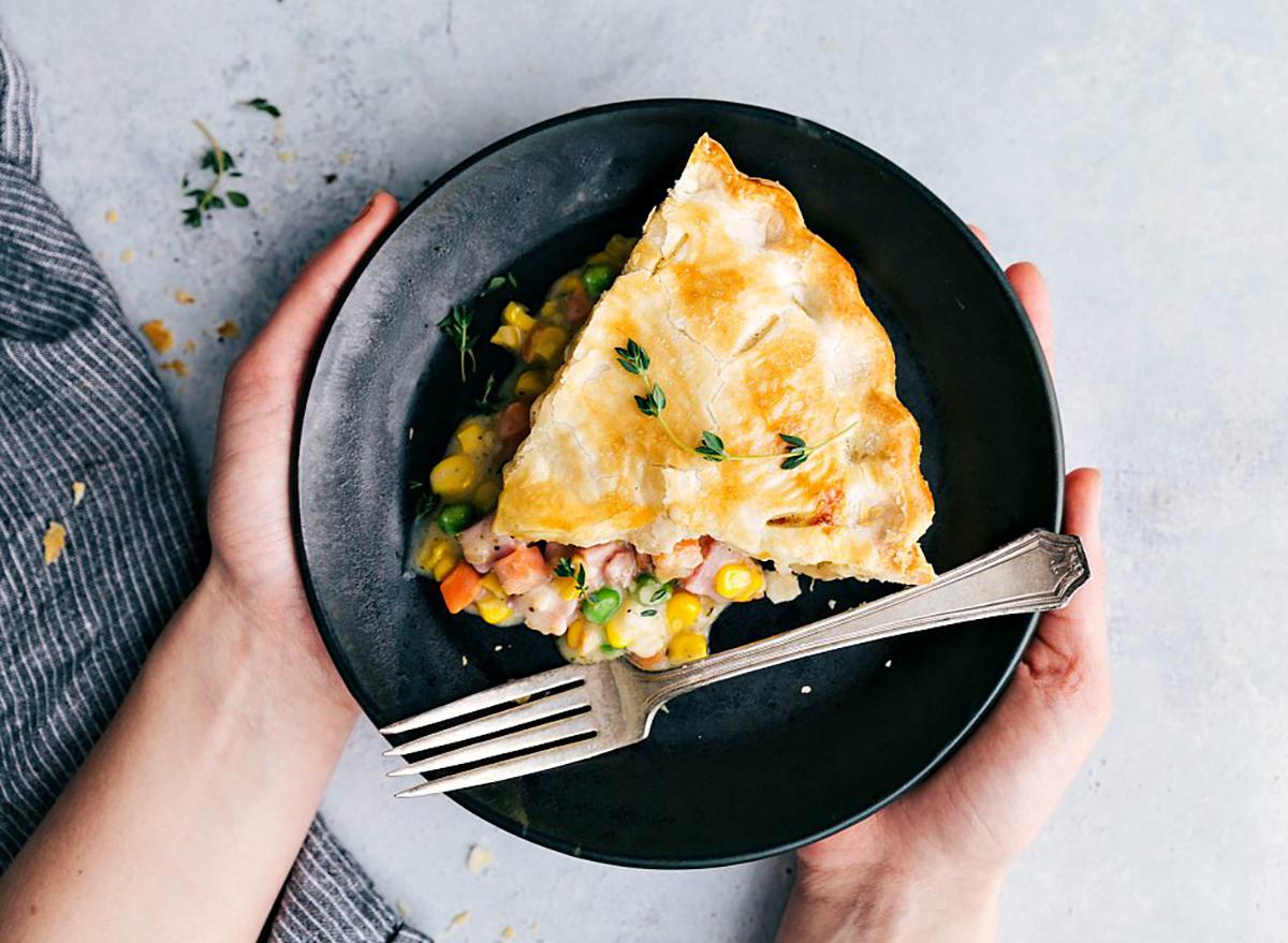 ham pot pie slice on black plate
