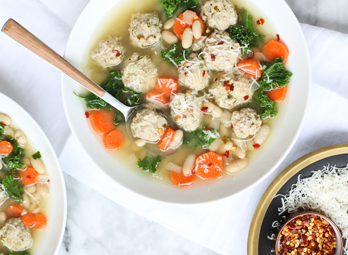 bowl of turkey meatball soup with kale and carrots