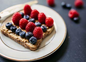 Berries on peanut butter toast