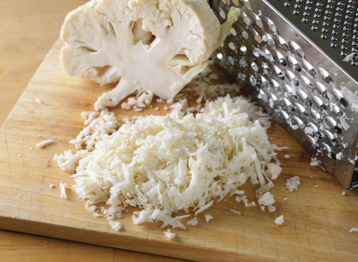 Grating cauliflower into cauliflower rice