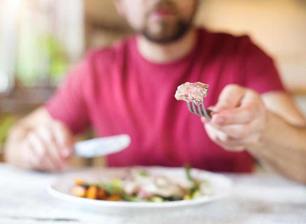 Man cutting food